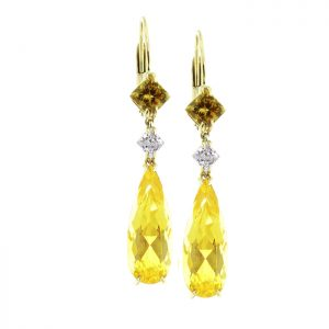 yellow gemstone earrings with diamonds